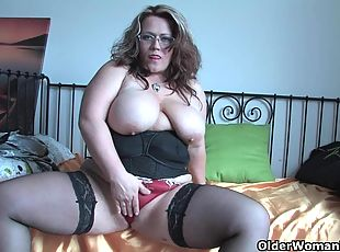 Chubby soccer mom in stockings rubs her mature pussy