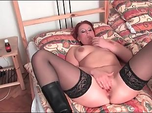 Curvy milf in stockings and boots masturbates solo