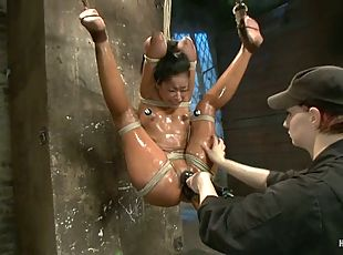 Exotic sex slave Skin Diamond is under oiled bondage