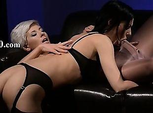 Fluent brunette sucking penis of rubber