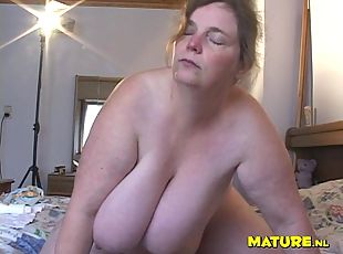 Busty older BBW has some fun with a large black sex toy